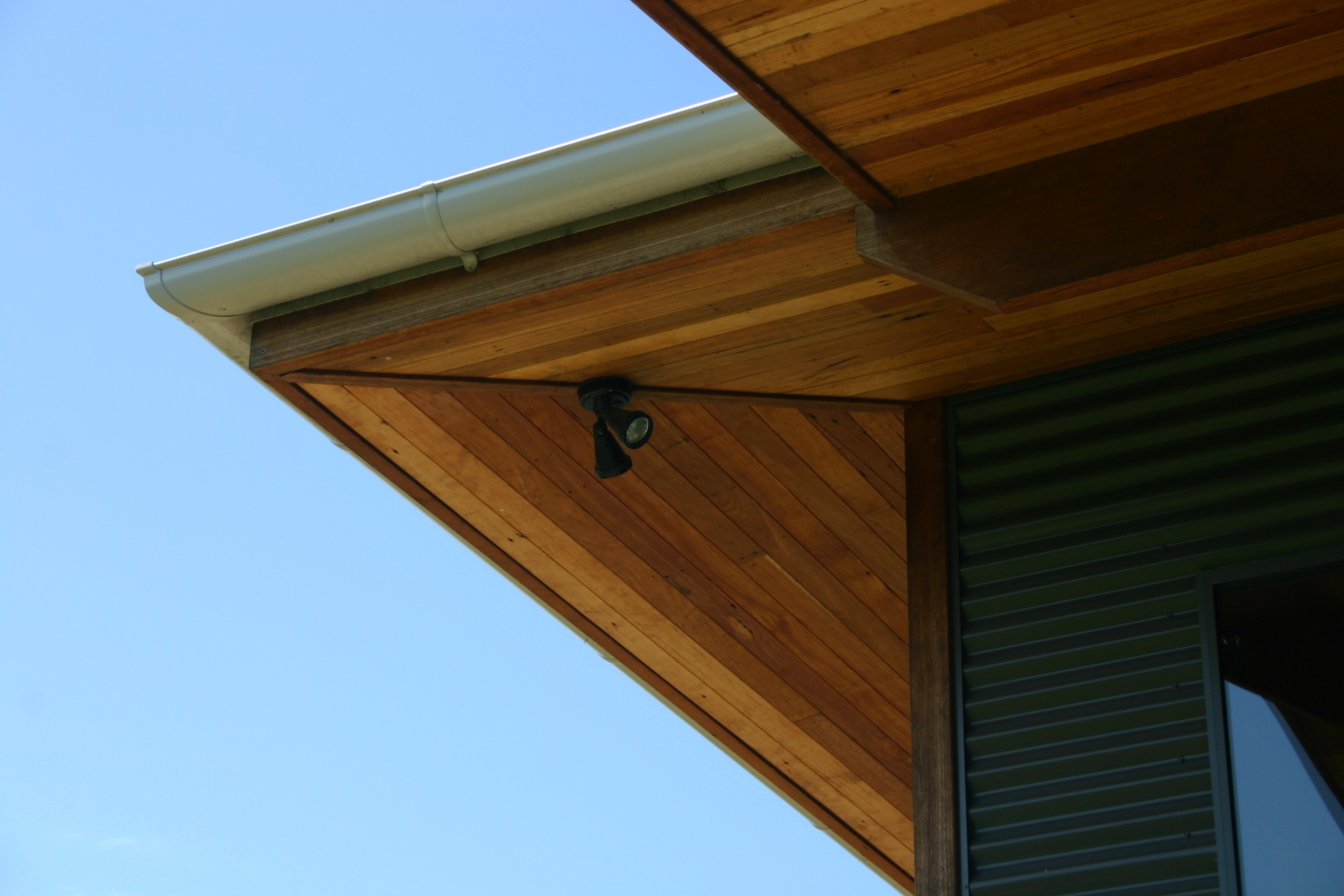 Timber Lined Eaves with calculated overhang and half-round gutter